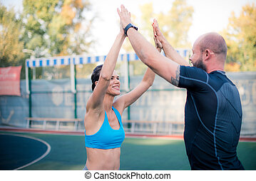 Friends giving high five on stadium - Friends giving high...