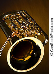 Tuba Euphonium Isolated on Gold - A gold color brass tuba...