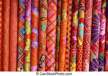 many colored fabrics with a technique called BATIK. This is...
