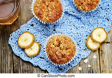 Oats banana muffins on wood background. toning. selective...