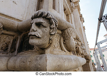 One of the sculptures of the head of the Cathedral of St....