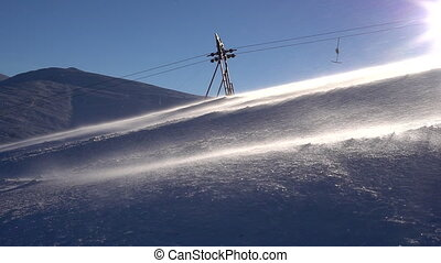 Ski lift moving up to the mountain. - Ski lift moving up to...