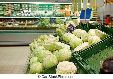 close up of cabbage at grocery store or market - sale,...