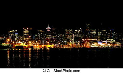 City Waterfront At Night - Vibrant cityscape with tall...