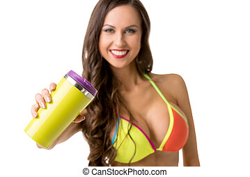 Athletic woman in bikini with shaker on white