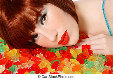 Candies - Portrait of young beautiful sexy redhead girl...