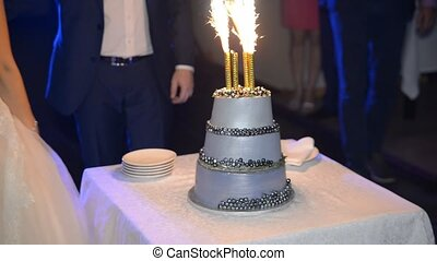 wedding cake with fireworks on the background of couple