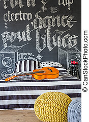 Cosy musical teenager bedroom in black and white colors