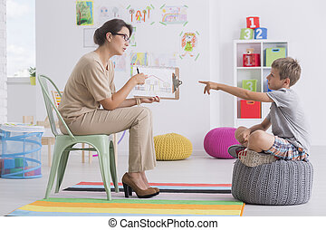 Woman conducting child's psychological test - Young woman...