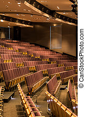 Spacious lecture room with wooden seats