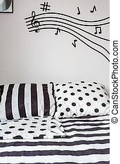 Striped and dotted sheet on bed - Trendy black and white...