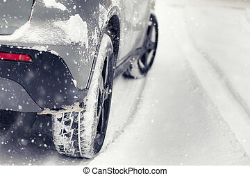 Car passing in the snow storm