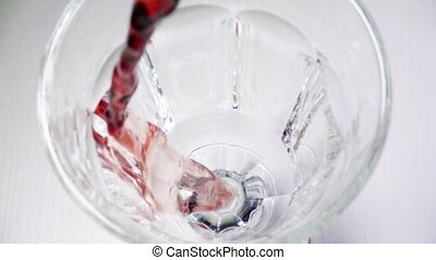 Slow mo red wine in a wineglass top view - Slow mo red wine...