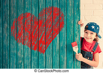 Valentines day concept - Happy child painting big red heart...