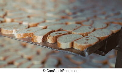 Close up of many fresh toasts with raisins in 4K.