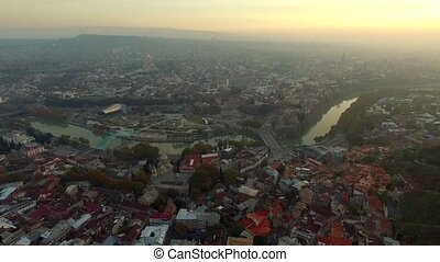 Evening in Tbilisi, Georgia, aerial - Getting darker in the...