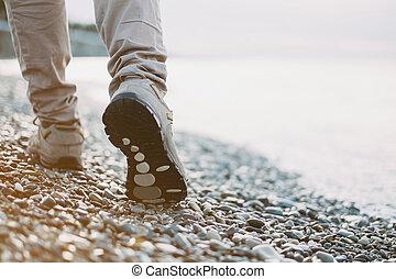 Walk on pebble coast