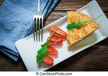 Spanish food omelette - Spanish potato omelette portion on...