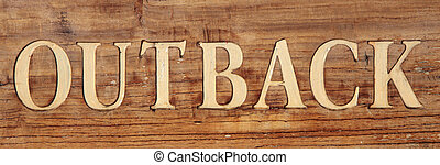 Outback as a term on rustic wooden board.