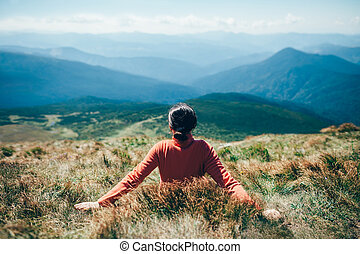 Freedom woman relax on rocky cliff and enjoying view. Travel...