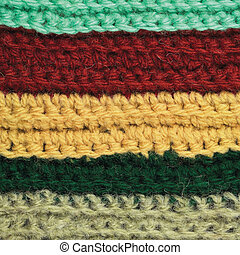 Knitted fine wool garment colorful stripes background natural texture, yellow, beige, claret, blue, green scarf macro closeup, large detailed textured knit vertical pattern, horizontal woolen