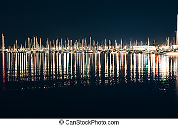 Yachts and boats in marina of La Spezia at night with...