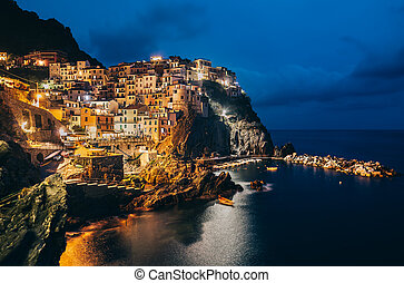 Night view of Manarola fishing village in Cinque Terre,...