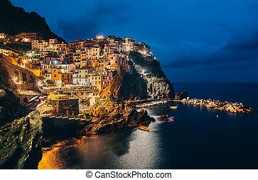 Night view of Manarola fishing village in Cinque Terre,...