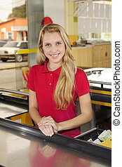 Woman working as a cashier at the supermarket - Young woman...