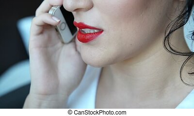 Smartphone girl talking by mobile phone and smilling in a...