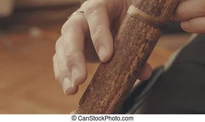Hands of musician plays the flute. Close up