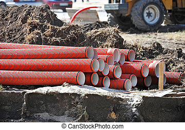 Stacked PVC pipe - Stacked new PVC pipe on construction site