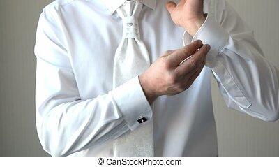man buttons shirt