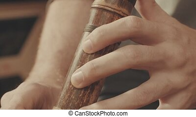 Hands of musician plays the flute.