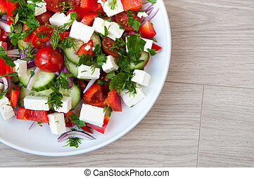 Freshly made Greek salad with vine ripened tomatoes and...