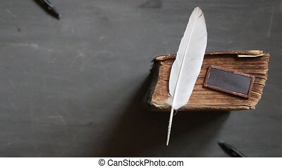 school courses idea. - Feather pen and old book on...