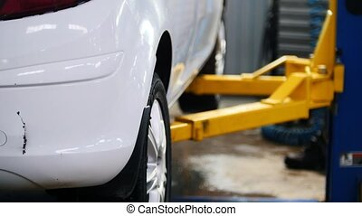 White car on lifts for repairing, automobile service,...