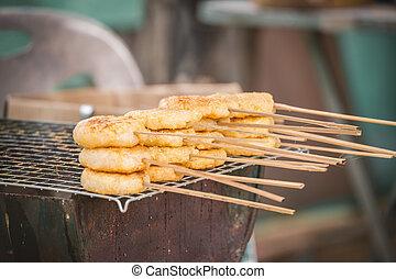 Toast sticky rice on strove - Toast sticky rice coated by...