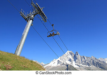 Bikers on a chairlift in the mountain