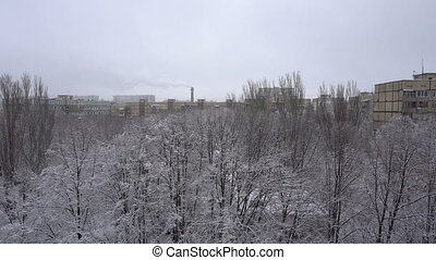The city snow fell. Houses and trees in the snow. Panorama