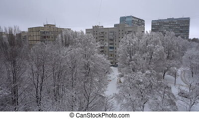 The city snow fell. Houses and trees in the snow