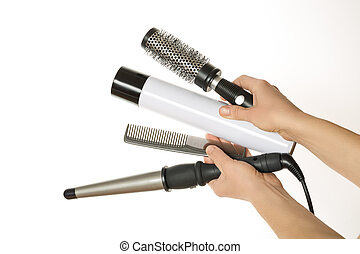 Hands holding curling hair and accessories - Hairdresser...