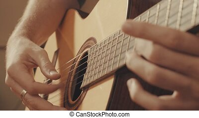 Hands of guitarist playing a guitar. Close-up 4K
