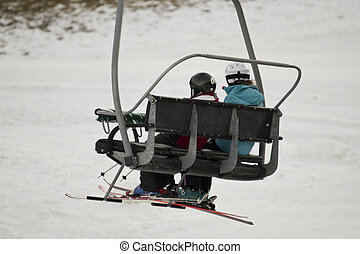 Chairlift with skiers at a ski resort