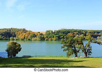 beautiful autumnal landscape with lake and trees - beautiful...