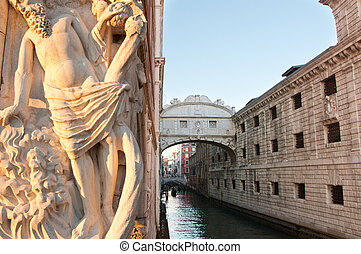 Bridge of Sighs and artistic sculpture in Venice, Italy.