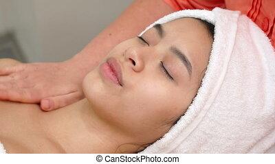 Masseur massagges woman's neck - Masseur massaging woman's...