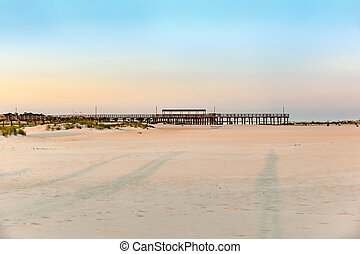 romantic sunset with wooden pier at Dauphine Island -...