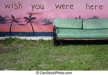 Sofa and wall - Sofa on the grass by a colorful painted wall
