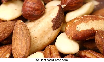 Close up of nuts rotating by - Close up of mixed nuts...